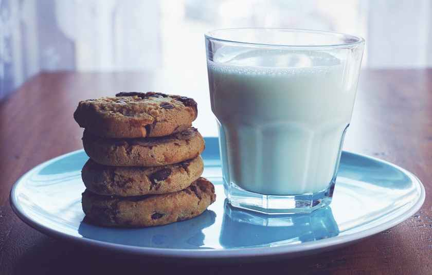baked cookies and glass of milk